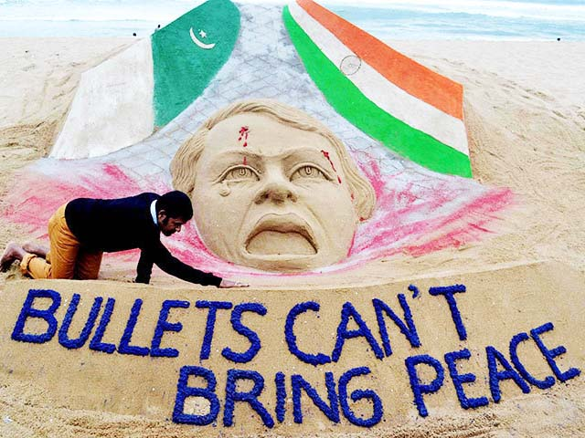 Indian sand artist Sudarsan Pattnaik gives final touches to his sand sculpture at Puri beach on October 9, 2014. PHOTO: AFP
