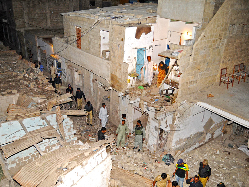 A view of the destruction caused by a bomb blast near Orangi Town. PHOTO: MOHAMMAD NOMAN / EXPRESS