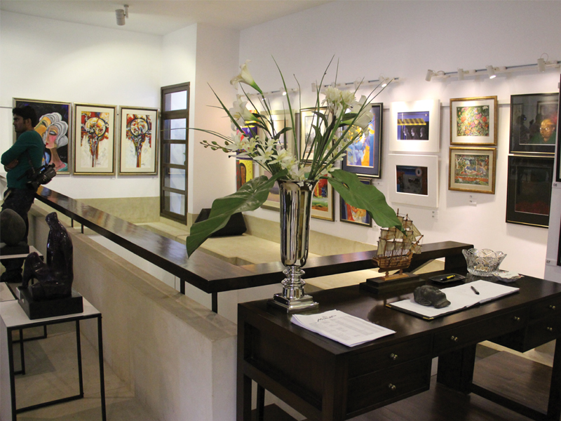 The Momart Art Gallery has relocated to a new venue near Bilawal House. The works by 67 artists decorated the gallery's walls on its grand relaunch on Monday. The paintings of some of the artists can be seen above. PHOTO: AYESHA MIR/ EXPRESS