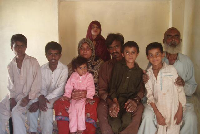 Imran (second from the right), a victim of child trafficking, poses with his family in Rahim Yar Khan. PHOTO: ZAHID GISHKORI/EXPRESS TRIBUNE