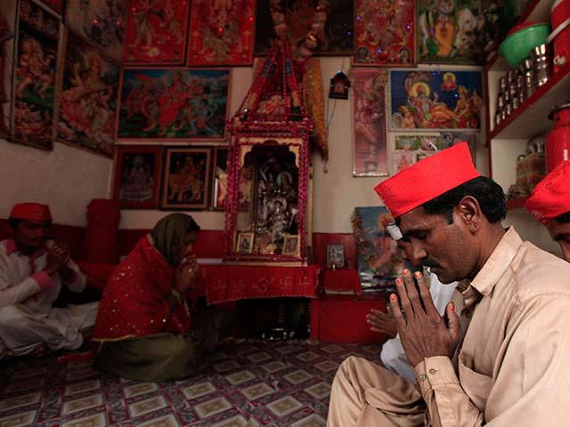 Members of Hindu community pray inside a temple in Rahim Yar Khan March 27, 2014. PHOTO: REUTERS