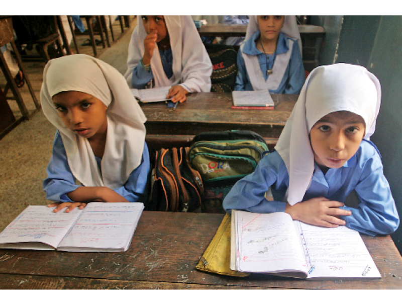 Female students in Lyari are struggling to get educated without being a burden on their families. They believe that is the only way to improve their neighbourhood's condition. PHOTO: ATHAR KHAN/EXPRESS