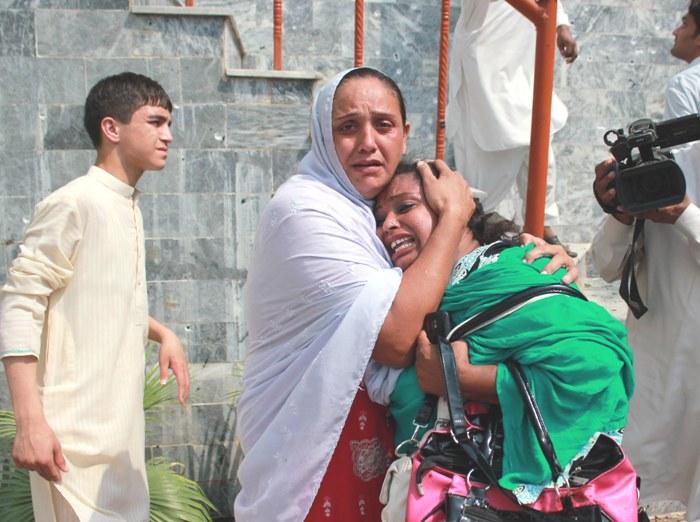 Relatives of the victims of Peshawar church blast. PHOTO: MUHAMMAD IQBAL