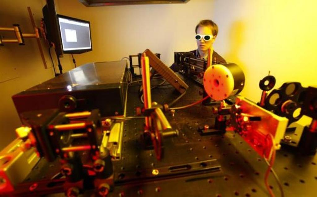 A dissertation student operates a newly developed 3D laser printer. PHOTO: REUTERS