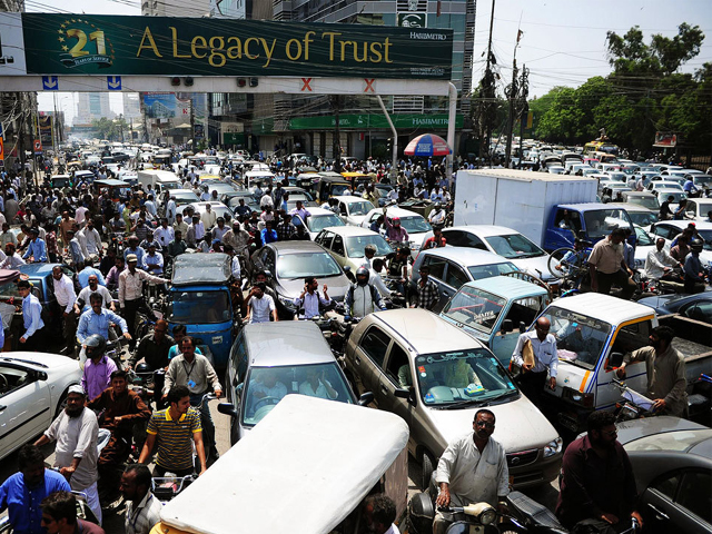 Pakistani commuters stuck in a traffic jam in Karachi on June 3, 2014. PHOTO: AFP
