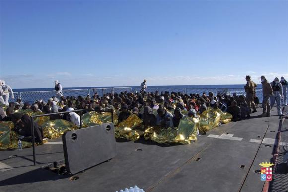 Migrants sit in a Marina Militare vessel during a rescue operation by Italian navy off the coast of the south of the Italian island of Sicily. PHOTO: REUTERS