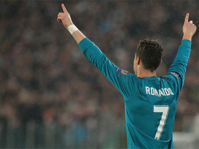 Cristiano Ronaldo of Real Madrid celebrates after scoring the opening goal during the UEFA Champions League Quarter Final Leg One match between Juventus and Real Madrid at Allianz Stadium on April 3, 2018 in Turin, Italy. PHOTO: GETTY