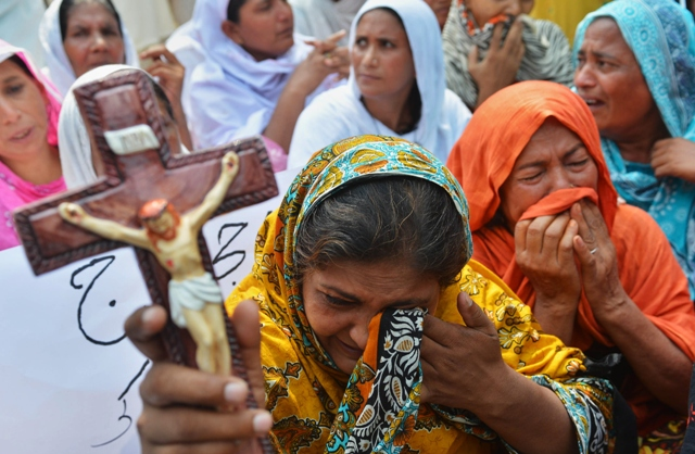 """The report also called 2013 """"one of the darkest years"""" for Christians in Pakistan, with the deadliest ever attack on the community mounted in Peshawar in September. PHOTO: AFP/FILE"""