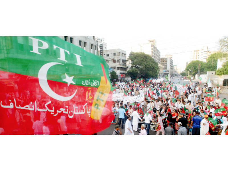 Activists of the PTI and JI organised a rally outside the office of the provincial election commission to protest the rigging in the polls. PHOTO: ATHAR KHAN/EXPRESS