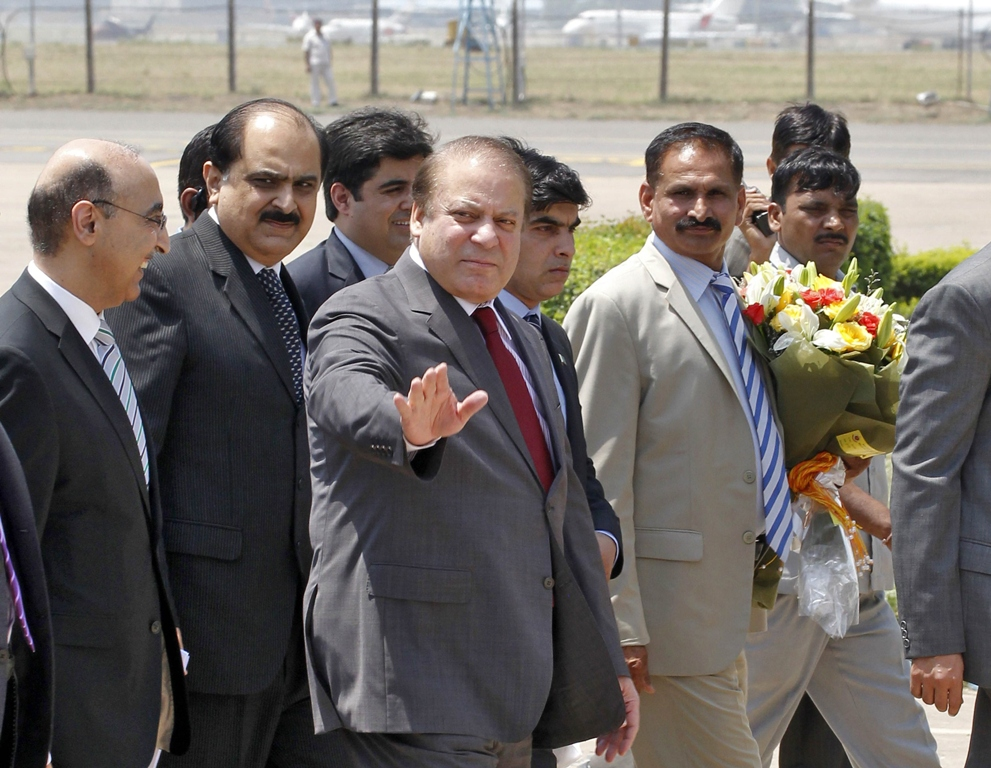 Prime Minister Nawaz Sharif waves upon his arrival at the airport in New Delhi May 26, 2014. PHOTO: REUTERS