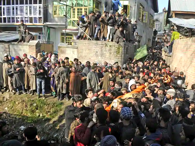 Villagers carry body of Zahoor Ahmed during his funeral procession, at Sirnoo village on December 15, 2018, in Pulwama, south of Srinagar, India. PHOTO: GETTY