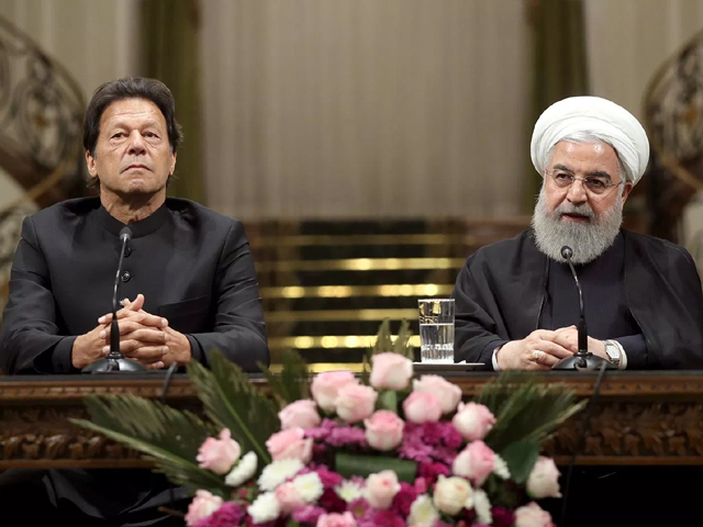 Pakistan Prime Minister Imran Khan and Iranian President Hassan Rouhani address a joint press conference. PHOTO: AFP