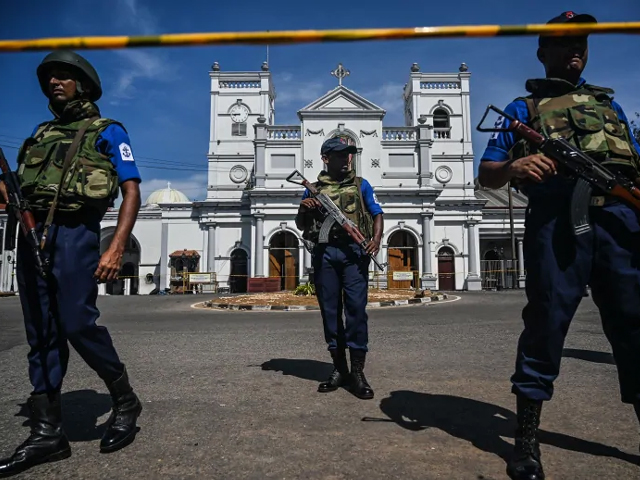Security personnel stand guard outside St. Anthony's Shrine in Colombo on Monday, a day after the church was hit in series of bomb blasts targeting churches and luxury hotels in Sri Lanka. PHOTO: AFP