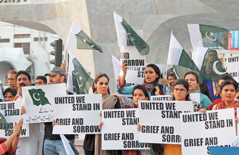 Members of civil society gathered at Teen Talwar on Monday to make sure the government does not forget the lives lost in the Peshawar school attack. PHOTO: AYSHA SALEEM /EXPRESS