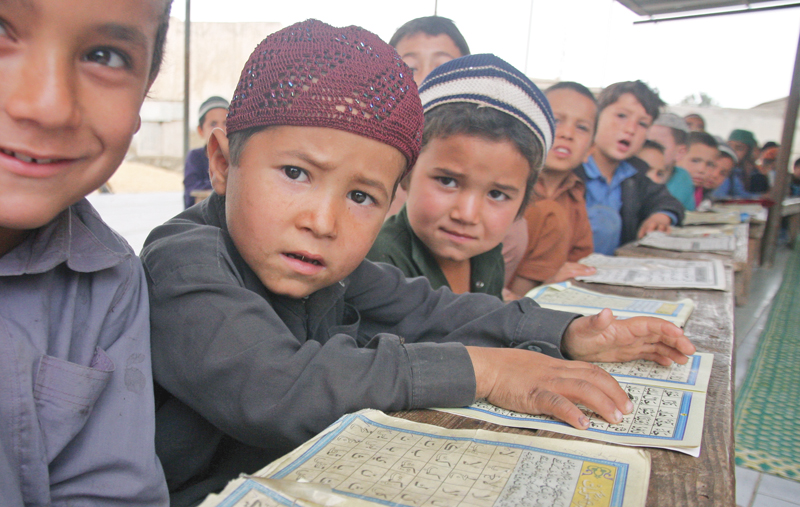Children of Afghan refugees in Karachi have few options when it comes to education and depend on madrassas in most cases . PHOTO: ATHAR KHAN/EXPRESS