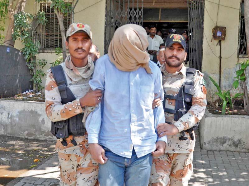 Rangers escort Umair Siddiqui from court premises. PHOTO: IRFAN ALI/EXPRESS