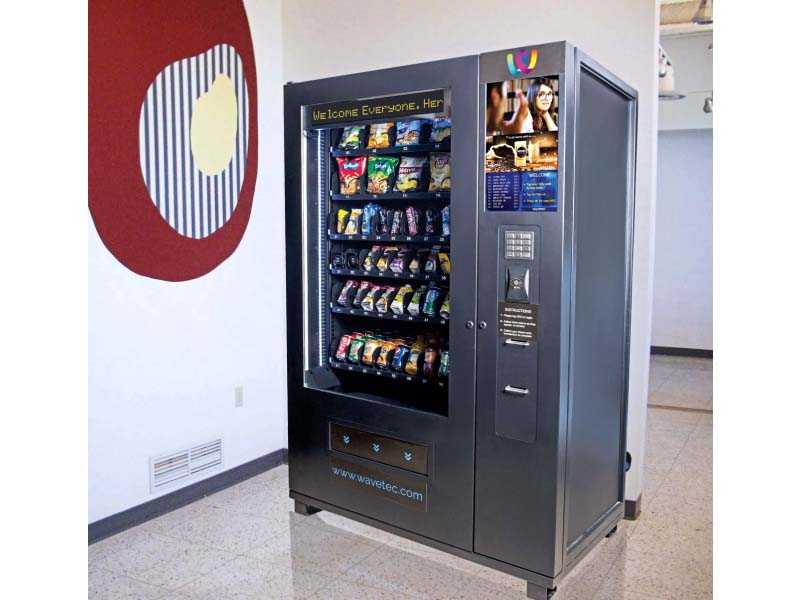 NFC enables users to wave over their smartphones or tap their plastic cards to an NFC-enabled vending machine, which then dispenses the item selected by the user. PHOTO: WAVETEC