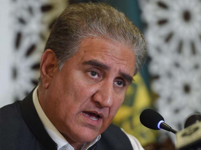 Pakistan's Foreign Minister Shah Mahmood Qureshi gestures as he speaks during a press conference focused on the Kashmir situation. PHOTO: AFP