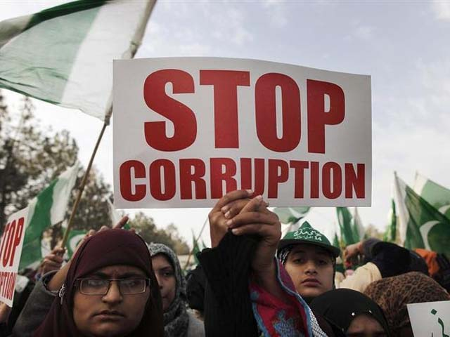 Protesters hold a sign as they take part in a protest in Islamabad. PHOTO: REUTERS
