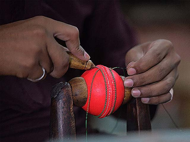 A worker stitches a pink cricket ball at a factory in Sialkot. PHOTO: GETTY