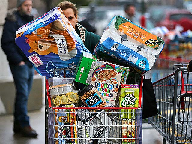 Shoppers stock up on staples including toilet paper, bottled water, diapers and canned goods. PHOTO: GETTY