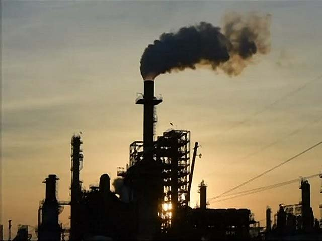 Smoke rises from the Lyondell Basell-Houston Refining plant. PHOTO: AFP