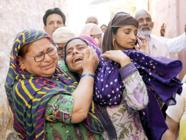 Mohammad Akhlaq's relatives mourn his death in the Bisara village of Uttar Pradesh. PHOTO: AFP