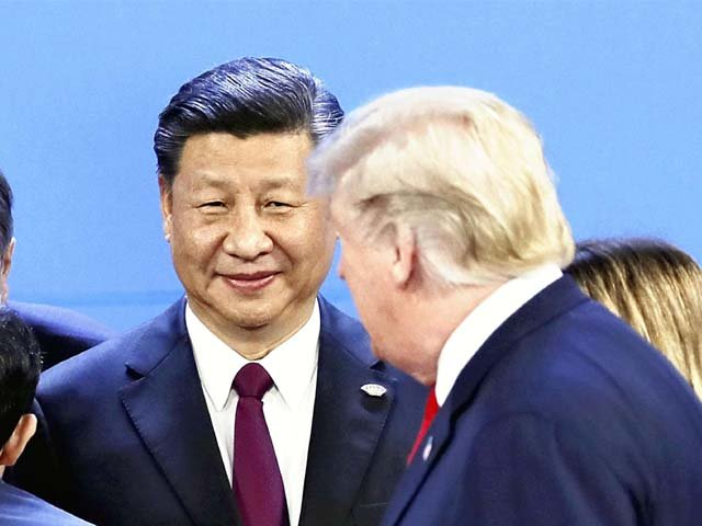 Donald Trump and Xi Jinping attend the G20 summit conference. PHOTO: AFP