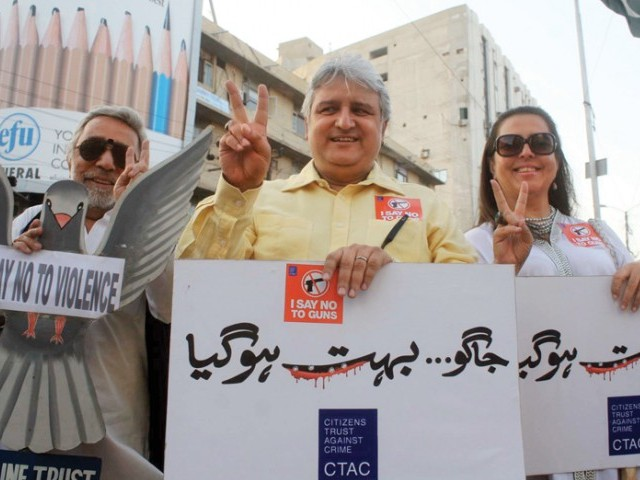 The Citizens Trust Against Crime held a protest at the Metropole Hotel to demand promotion of peace in the city, urging all civilians to voice their concerns over the law and order situation in Karachi. PHOTO: PPI