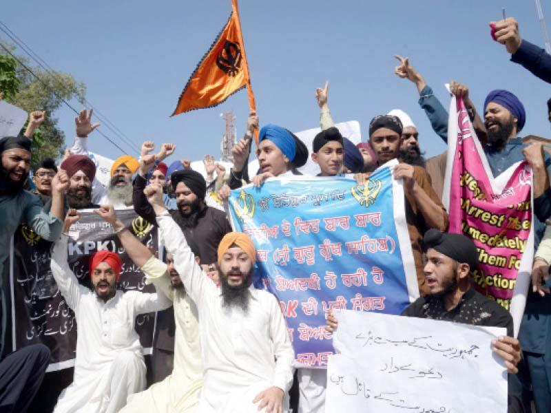 Sikhs outside Peshawar Press Club. PHOTO: MUHAMMAD IQBAL/EXPRESS