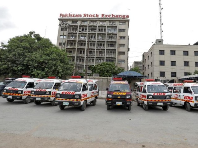 Ambulances are seen parked outside Pakistan Stock Exchange building after the terrorist attack in Karachi. PHOTO: REUTERS