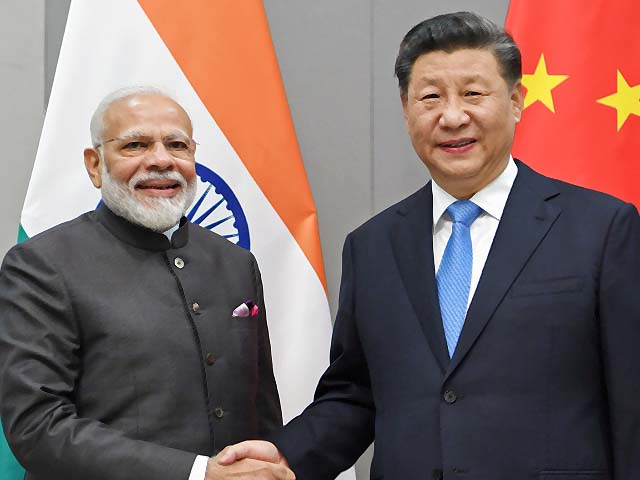 Xi Jinping meets with Narendra Modi in Brazil. PHOTO: AFP